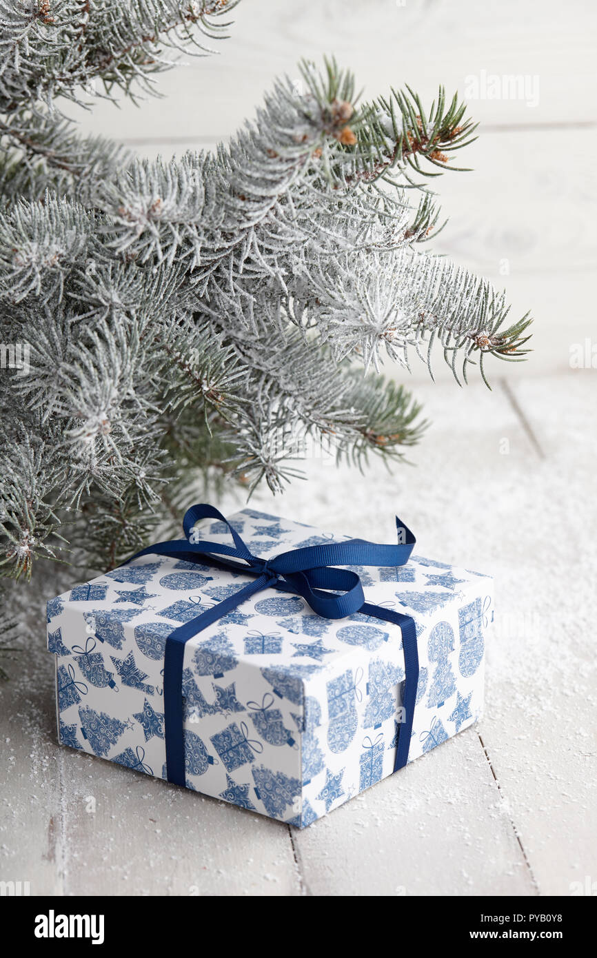 Christmas blue and white gift box with festive pattern and ribbon