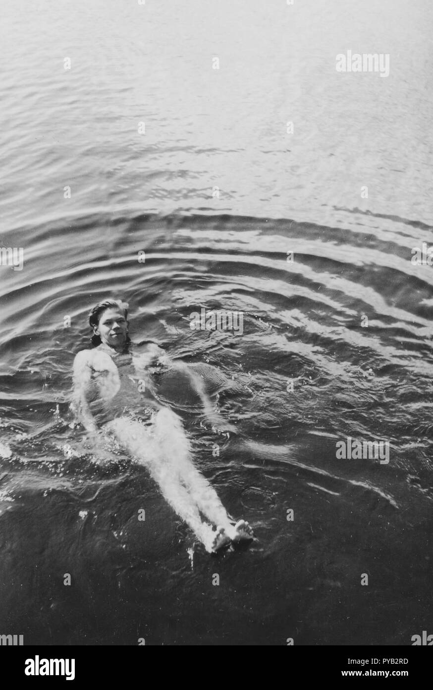 Having fun in the 1930s. A young man is having a swim. Sweden 1930s - Stock Image