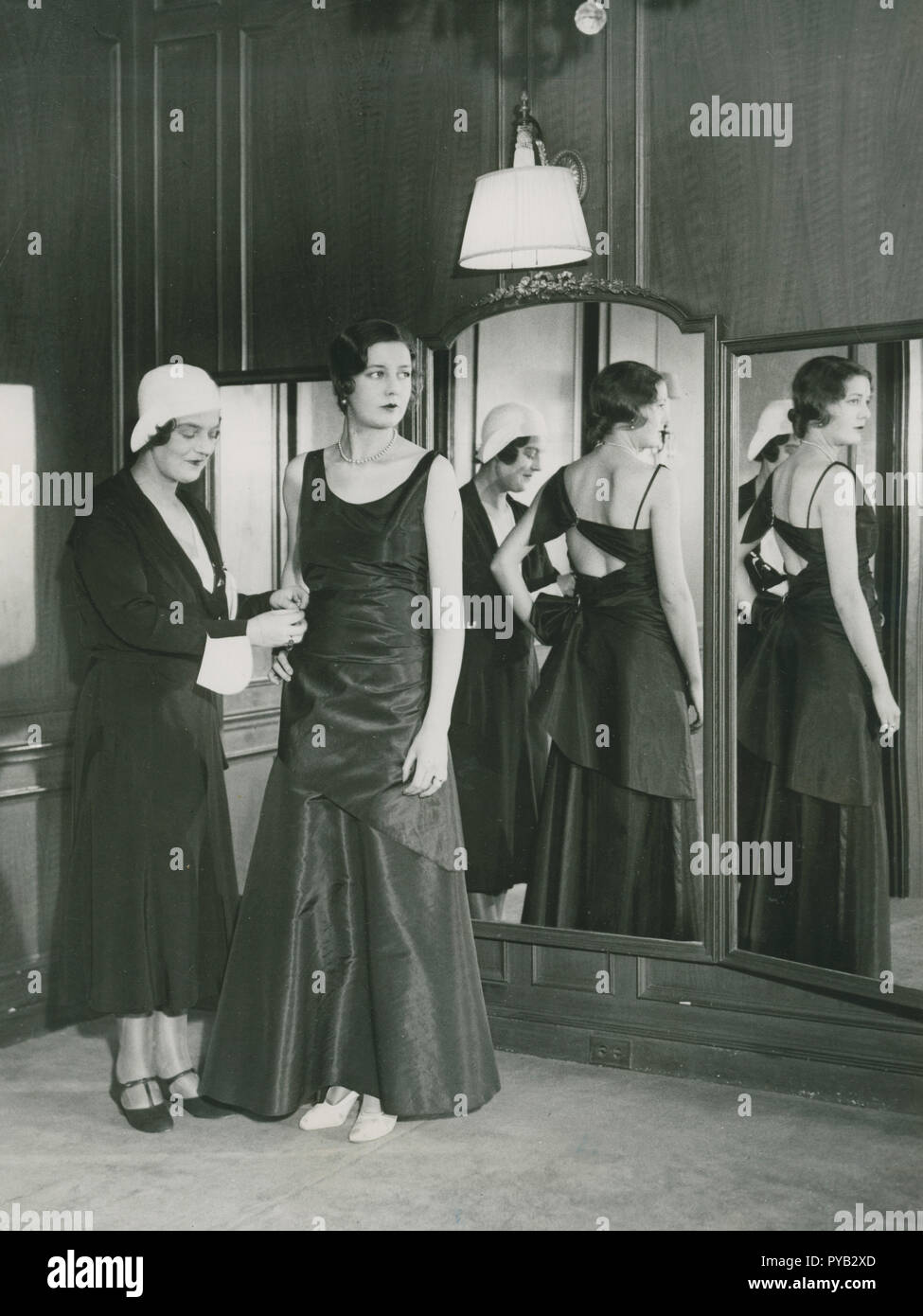 Ladies fashion in the 1930s. Pictured to the left  Grand Duchess Maria Pavlovna of Russia (1890–1958). She became interested in design and made business with Coco Chanel. She established herself as a fashiondesigner in America and her she presents an evening gown of her own design on Dec 17 1930. - Stock Image