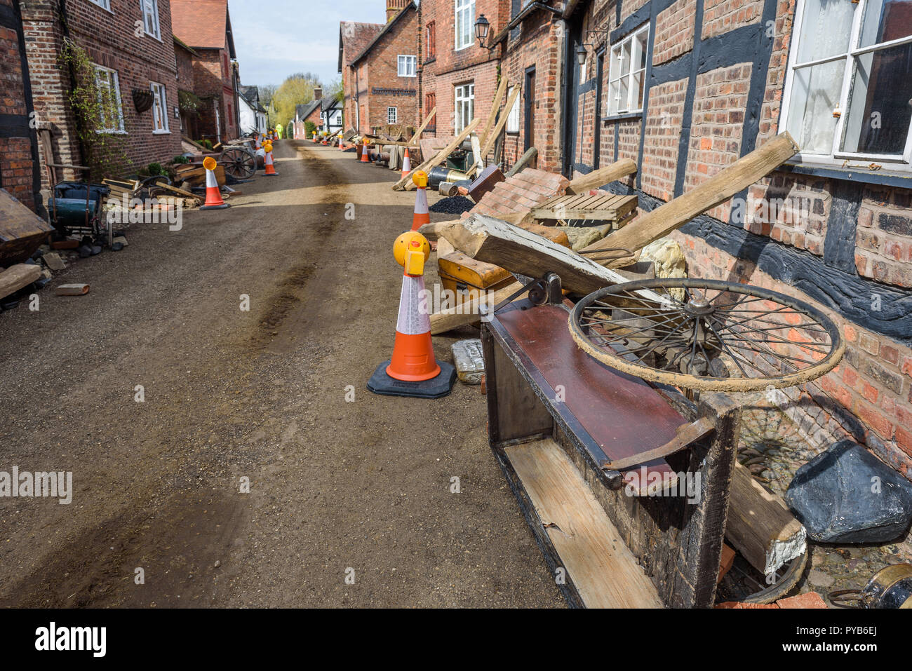 Props and debris litter alongside cottages for  the new BBC drama 'War Of The Worlds' by HG Wells,filmed at Great Budworth village, Cheshire, April 20 - Stock Image