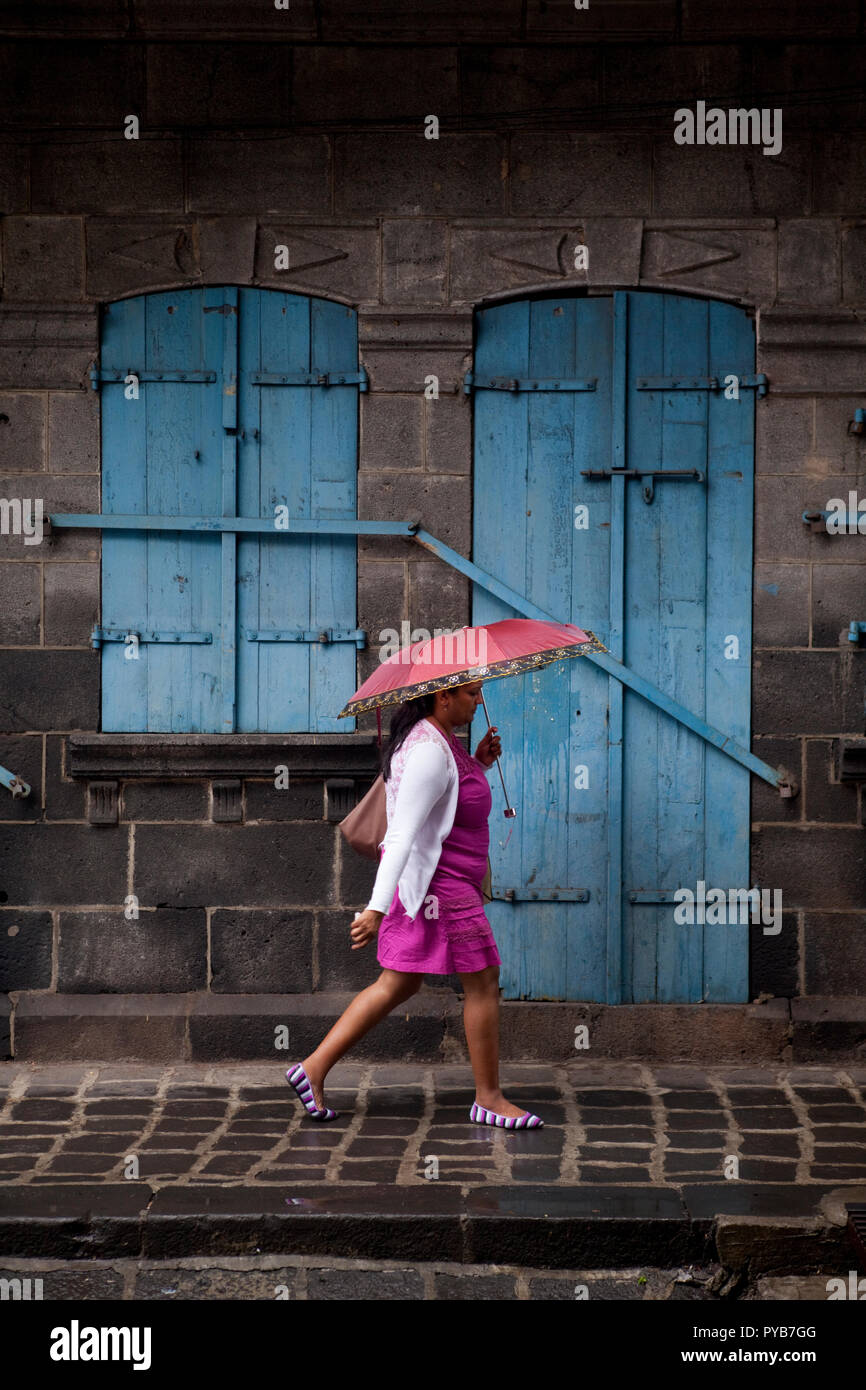 Street traffic during the rain in downtown Port Louis, Mauritius. - Stock Image