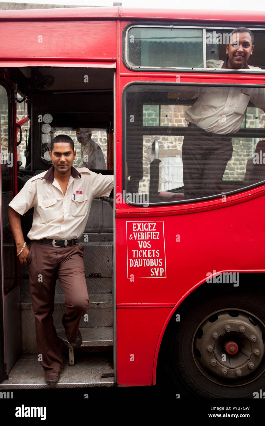 Bus drivers on duty in downtown Port Louis, Mauritius. - Stock Image