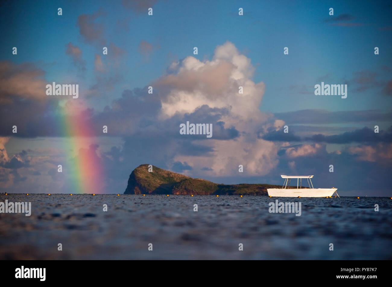 Rainbow over Flat Island, Mauritius. - Stock Image