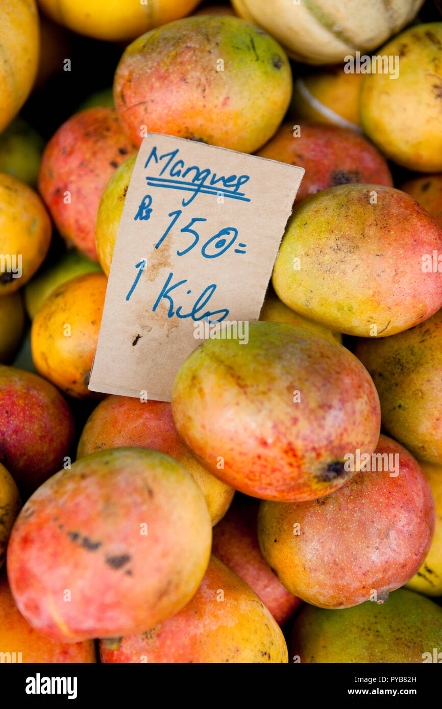 Mangoes for sale at the market in Port Louis, Mauritius. - Stock Image
