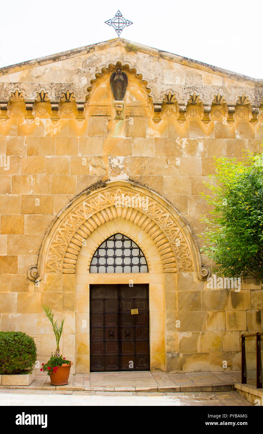 The door of the Church of St Ann at the ancient site of the Pool of Bethesda in Jerusalem Israel. The ornate stonework is a distictive achitectural fe - Stock Image