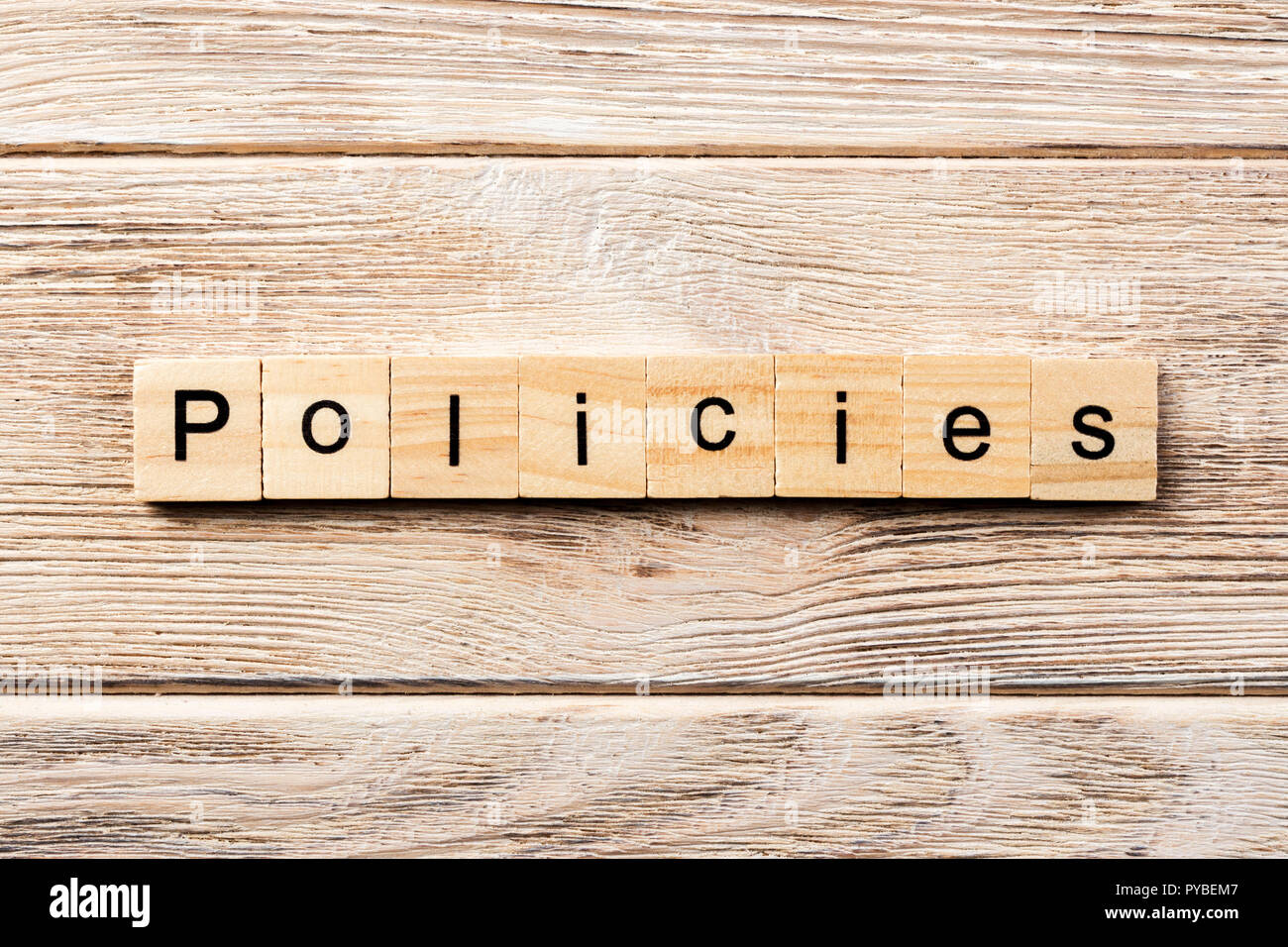 policies word written on wood block. policies text on table, concept. - Stock Image