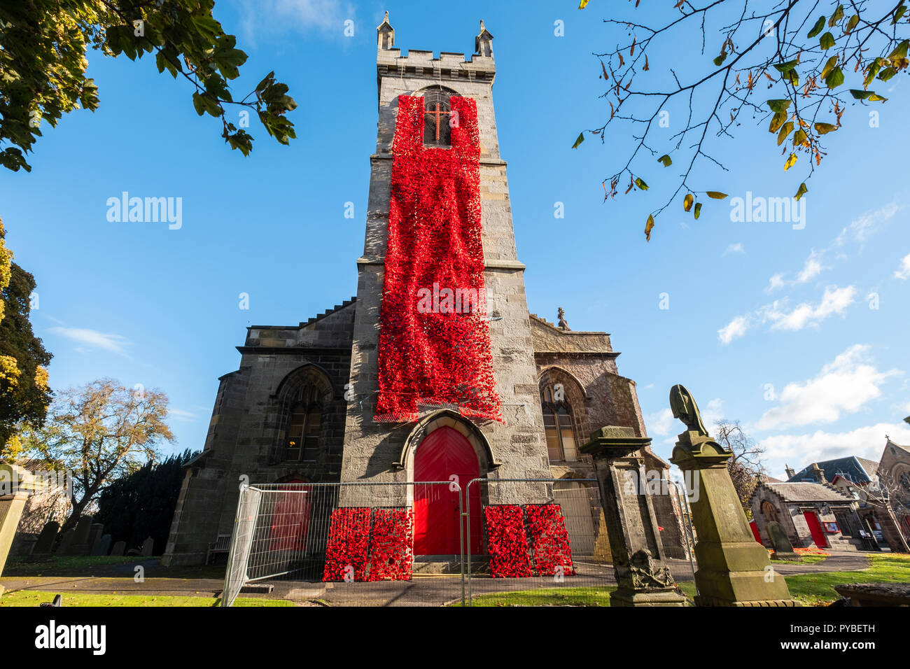 Edinburgh, Scotland, UK. 26 October, 2018. Liberton Kirk in Edinburgh is adorned with thousands of red poppies to mark the centenary of Armistice Day. The church bell tower is covered in a solid blanket of poppies made by the congregation. Credit: Iain Masterton/Alamy Live News - Stock Image
