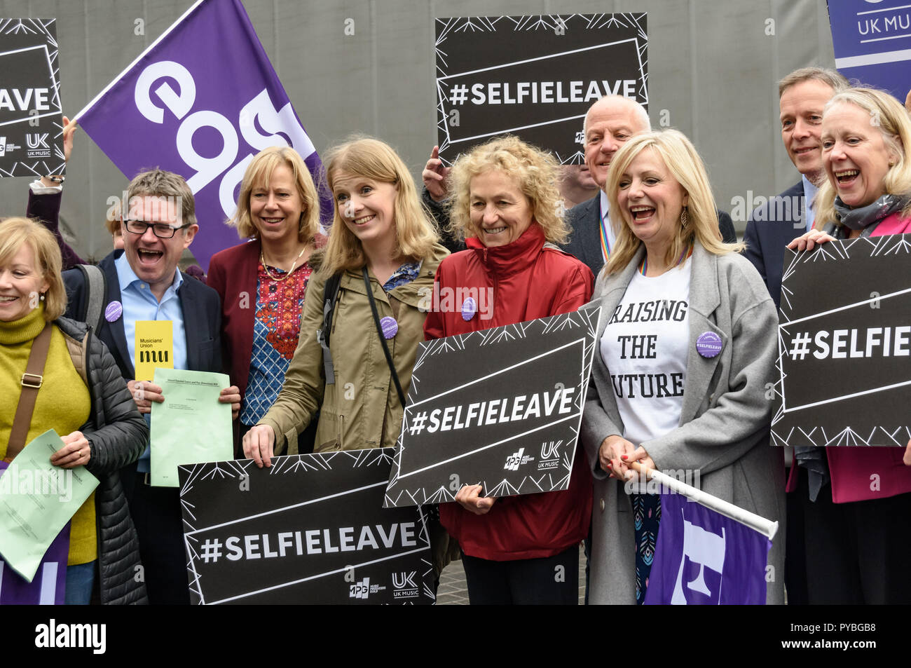 London, UK. 26th October 2018.  A photocall outside parliament marks the 2nd reading of Tracy Brabin MP's #SelfieLeave bill later which would give self-employed parents access to shared parental leave and pay was supported by members of Equity, UK Music, the Music Producers Guild and the Musicians Union. Currently women are forced to be the main carer, regardless of circumstances and fathers are denied any paid leave to look after their children, reinforcing outdated stereotypes and causing stress for thousands of families. Credit: Peter Marshall/Alamy Live News - Stock Image