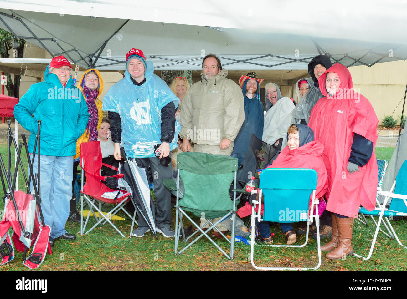 Charlotte, NC, USA. 26 October  2018. Trump supporters gladly brave the rain outside the Bojangles Arena in Charlotte in order to get good seats at the Trump MAGA Rally in Charlotte, NC tonight. Some supporters arrived at 3pm on Thursday and have camped out in tents.  Credit: Castle Light Images / Alamy Live News Stock Photo