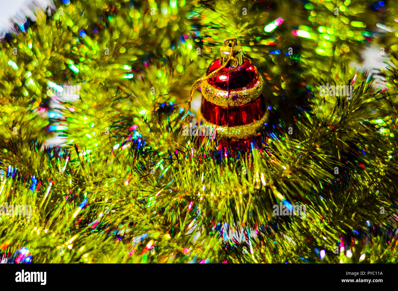 Decorated Christmas tree on blurred, sparkling and fairy elegant abstract background with bokeh lights and stars. Glowing abstract black and purple ab Stock Photo