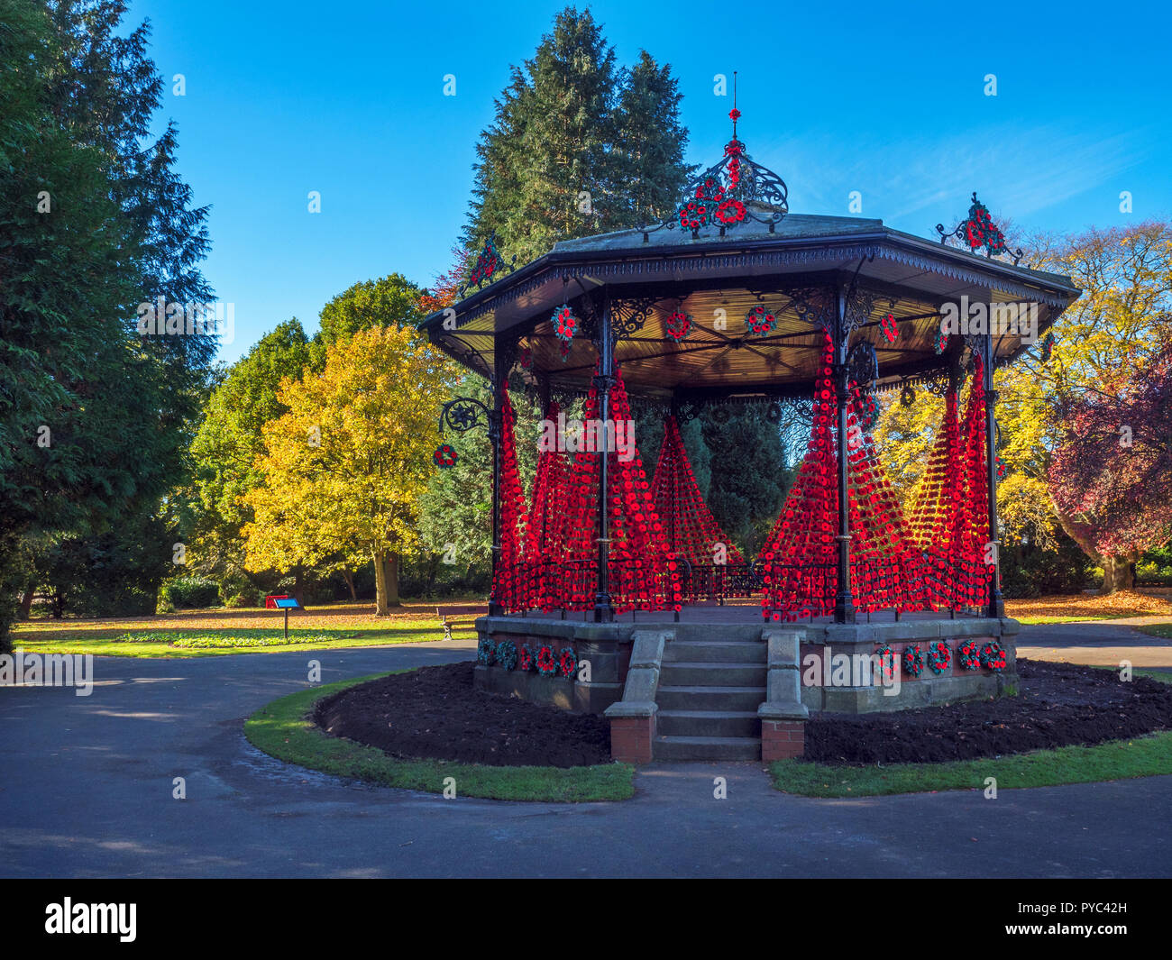 Poppies adorn the bandstand in the Spa Gardens marking 100 years since the end of the First World War Ripon Yorkshire England - Stock Image