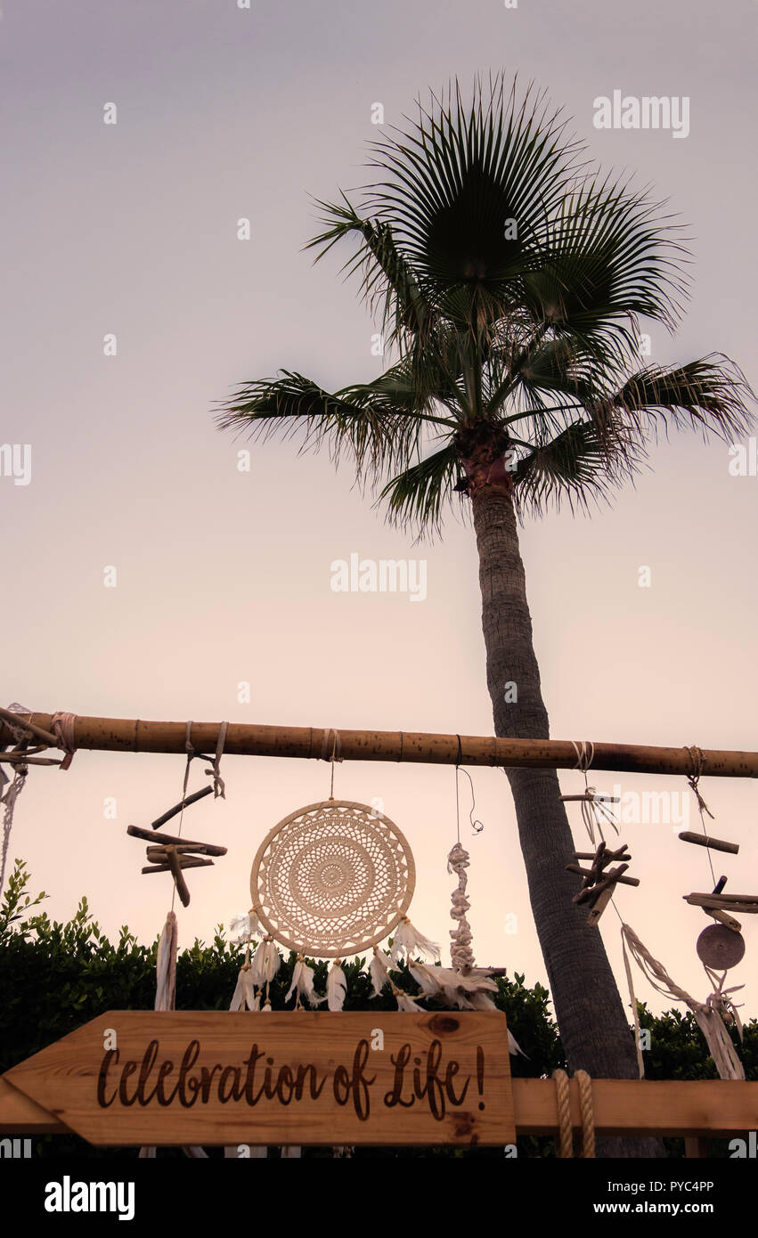 A boho image of dreamcatcher and wind chimes at sunrise, Marbella, Spain. - Stock Image
