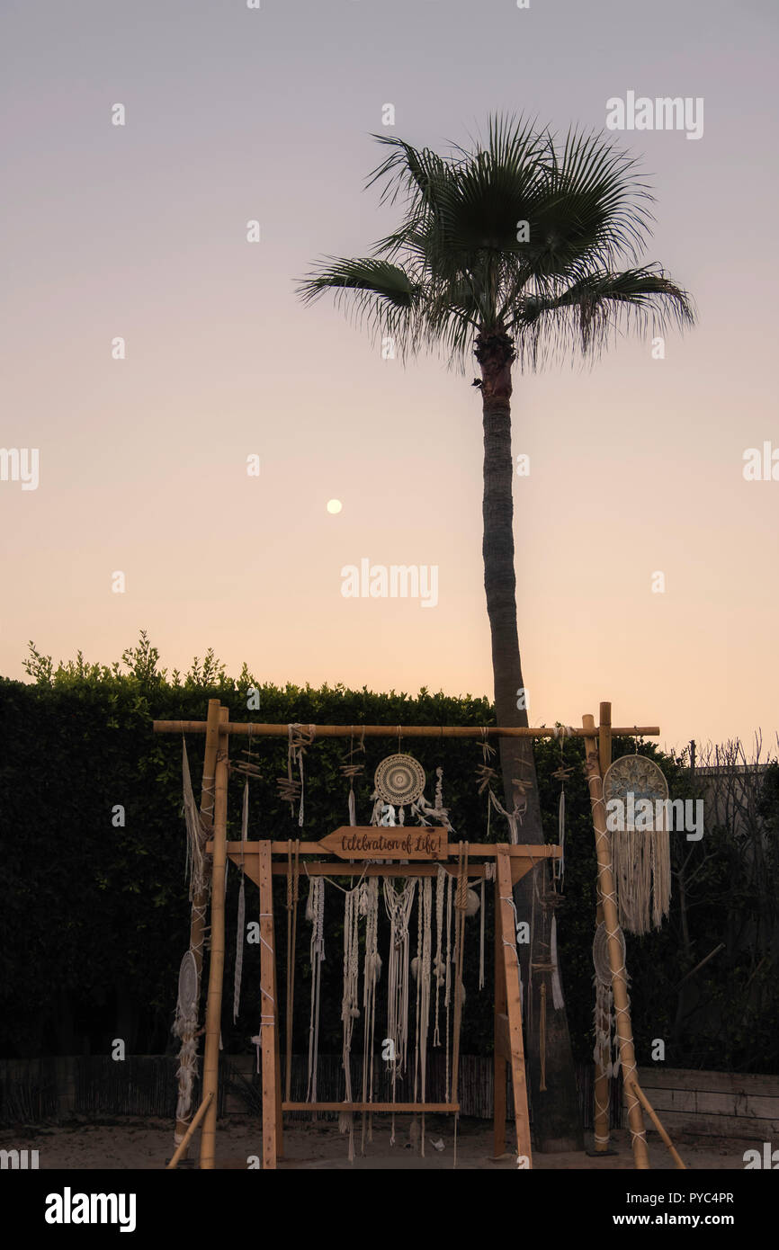 A boho image of a dreamcatcher and wind chimes at sunrise, Marbella, Spain. - Stock Image