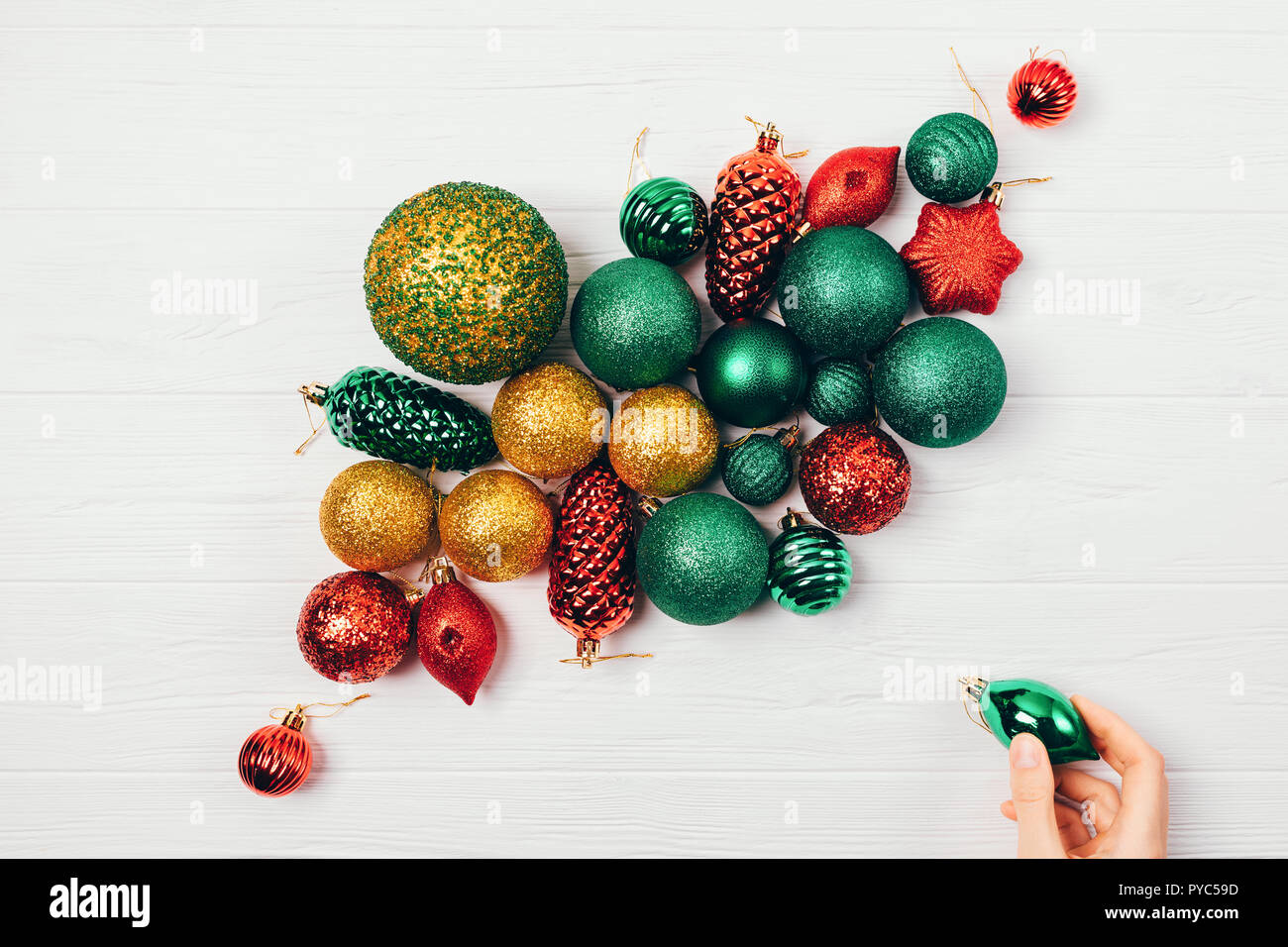 Christmas Decorations Balls On White Table Top View Female S Hand