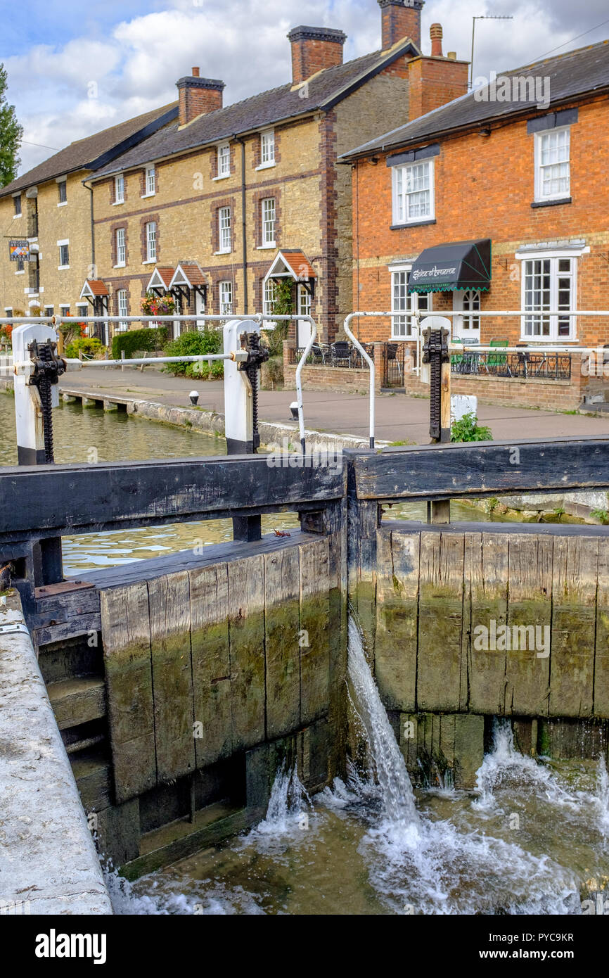 View across canal lock to The Canal Museum at Stoke Bruerne on the Grand Union Canal, Northamptonshire, England - Stock Image