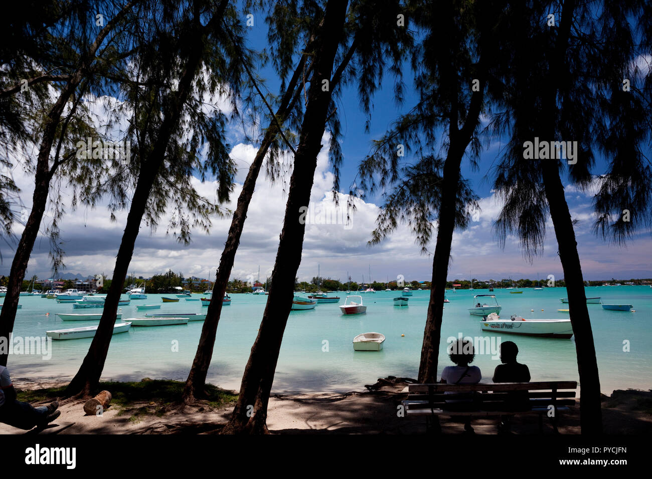 A view towards the harbour at Grand Baie on the north coast of Mauritius. - Stock Image