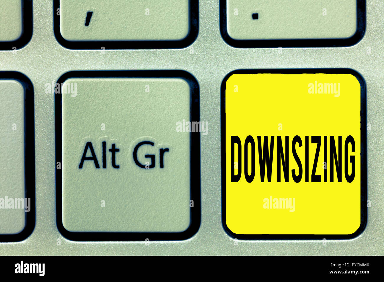 Conceptual hand writing showing Downsizing. Business photo text Make a company smaller by shedding staff Expenses reduction. - Stock Image
