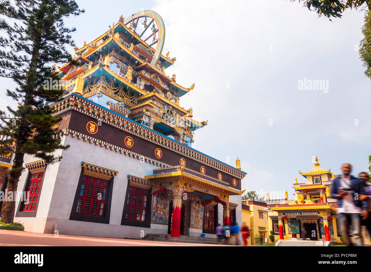 Bylakuppe, Karnataka, India - January 9, 2015: Entrance temple building and small meditation temple behind on the territory of the Namdroling Nyingmap - Stock Image