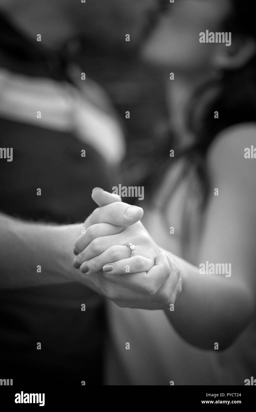 Engaged couple kissing holding hands with ring and manicure stock image
