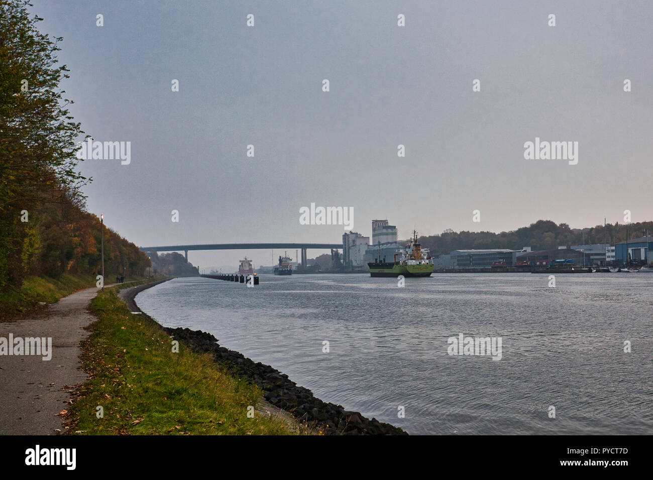 Nord-Ostsee-Kanal, Kiel. Deutschland Germany.  Several ships on the canal heading towards the sluice gates just past the Olympia bridge Kiel-Holtenau. - Stock Image