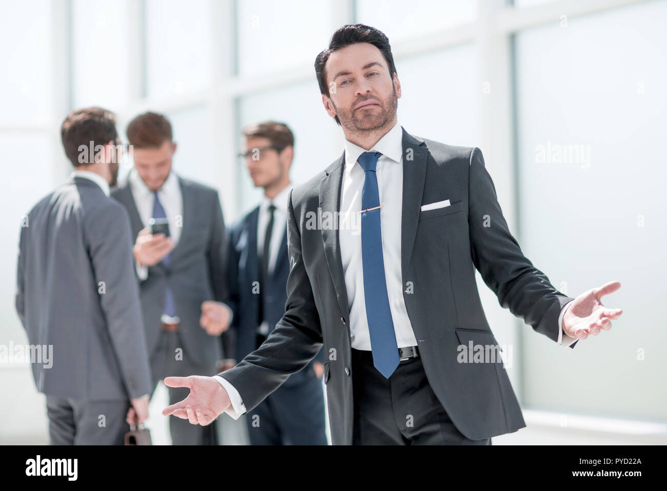 successful businessman inviting you to his office - Stock Image