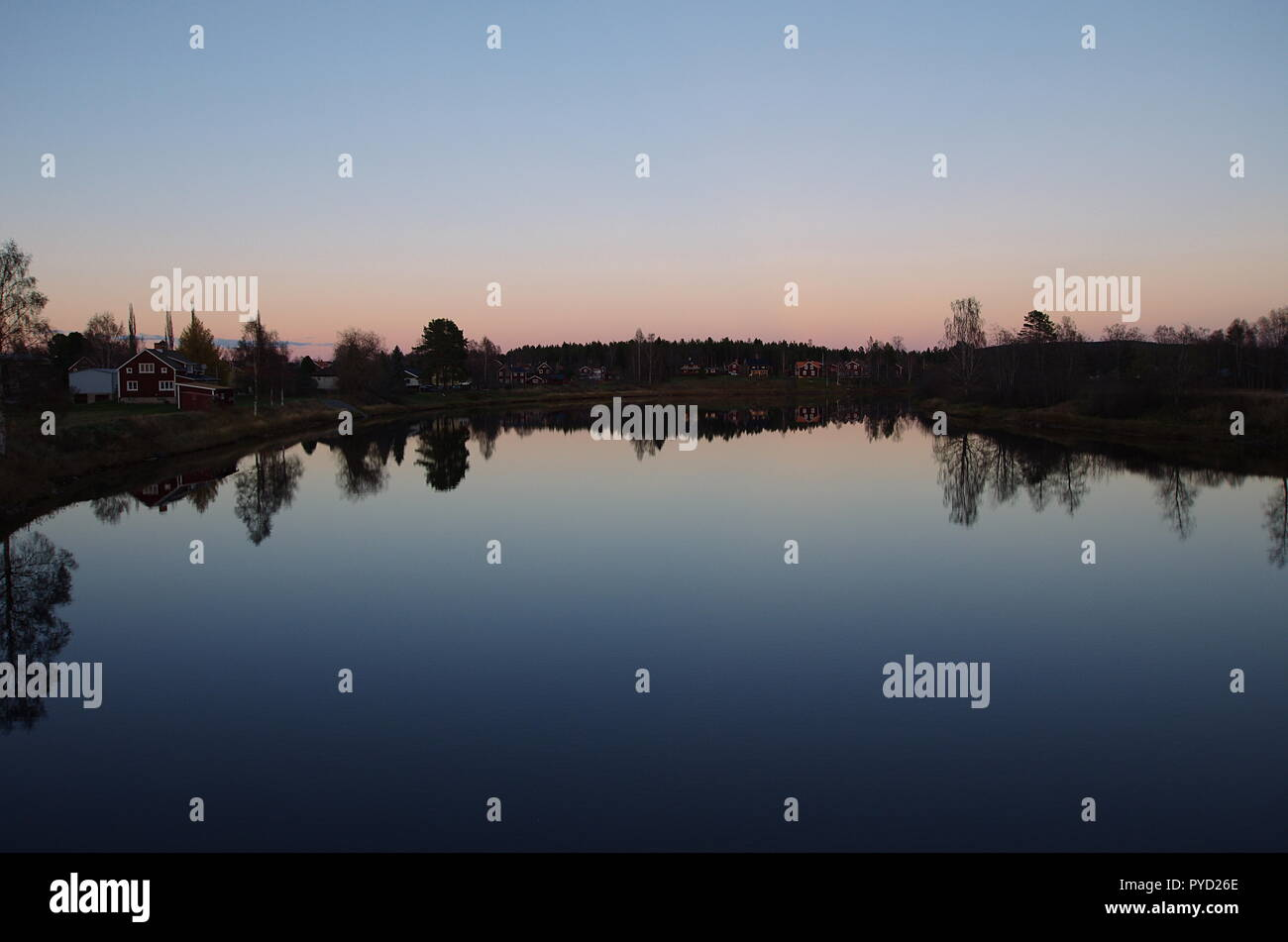 Beautiful sunset over a river in Dalarna. - Stock Image