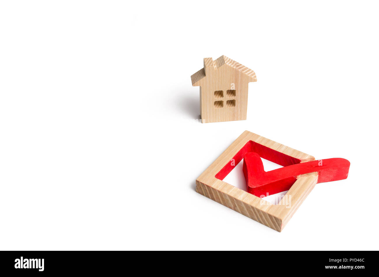 Wooden house and a tick in the box. concept of finding a home and moving to a new home. Standardization, search for the best option. Renovation and re - Stock Image