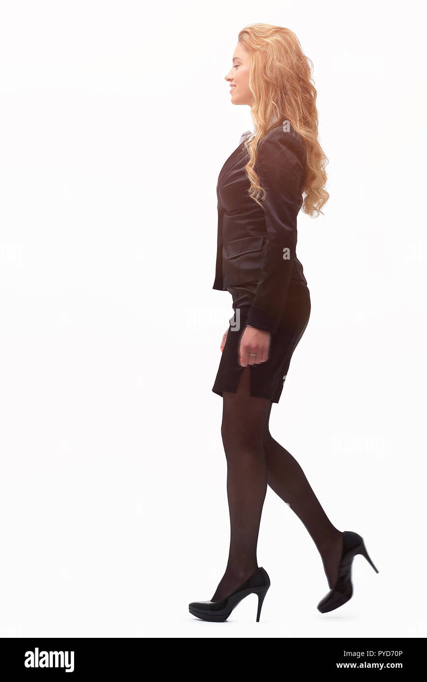 side view.business woman strongly going forward. - Stock Image