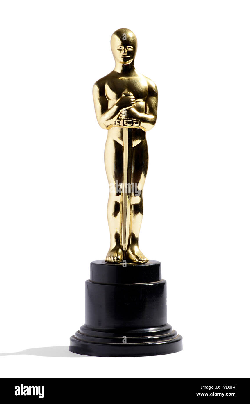 Golden replica of an Oscar film award on a black plinth isolated on white in vertical format - Stock Image