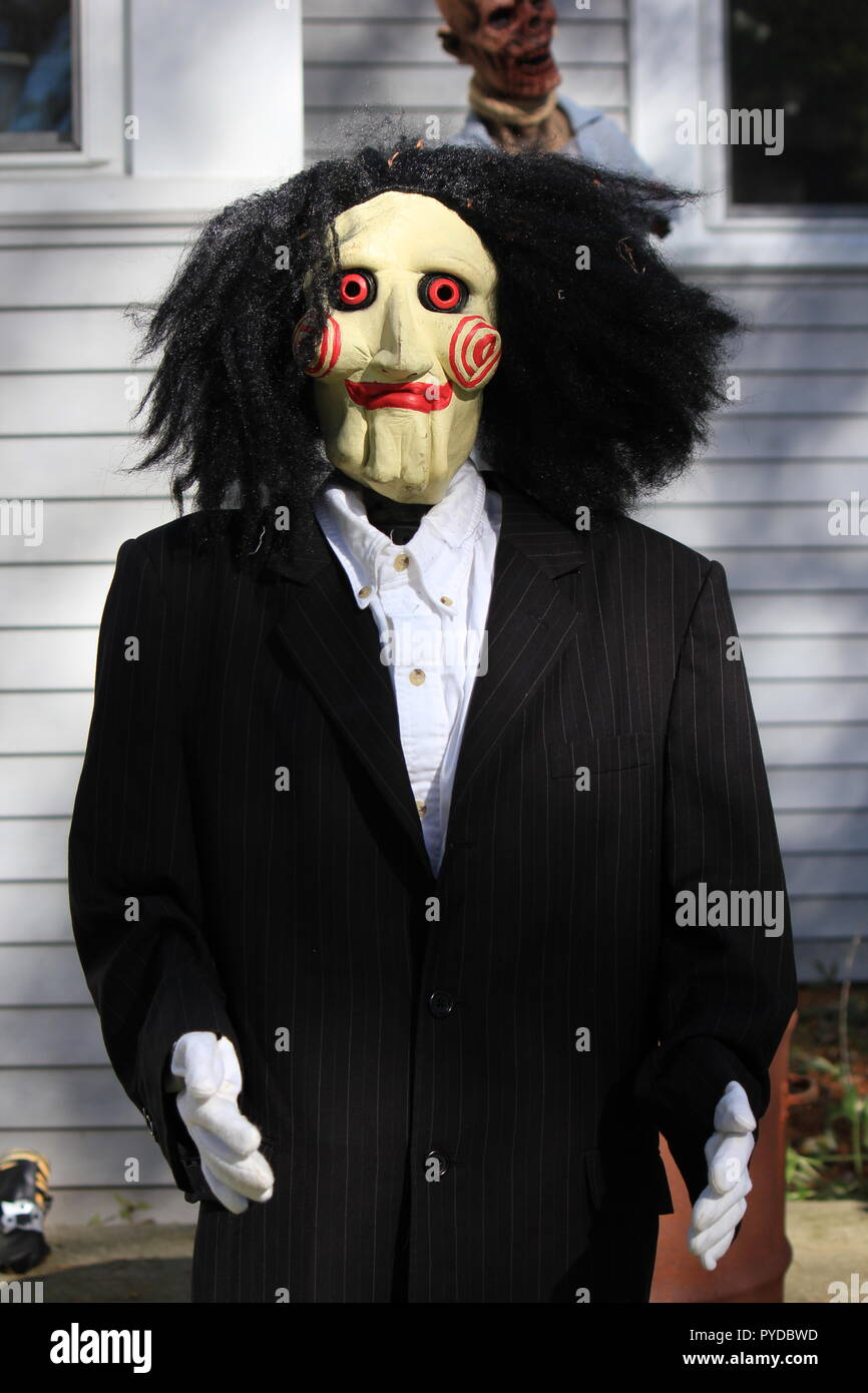 Monster dressed in formal wear as creative Halloween lawn decorations. - Stock Image