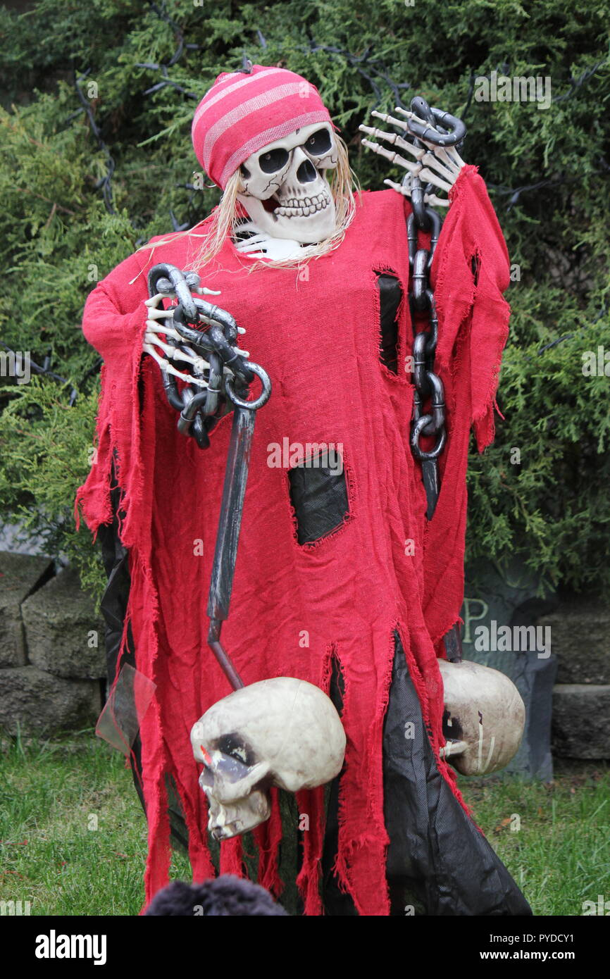 Skeleton Ghost Dressed In Red Rags And Carrying Chains And