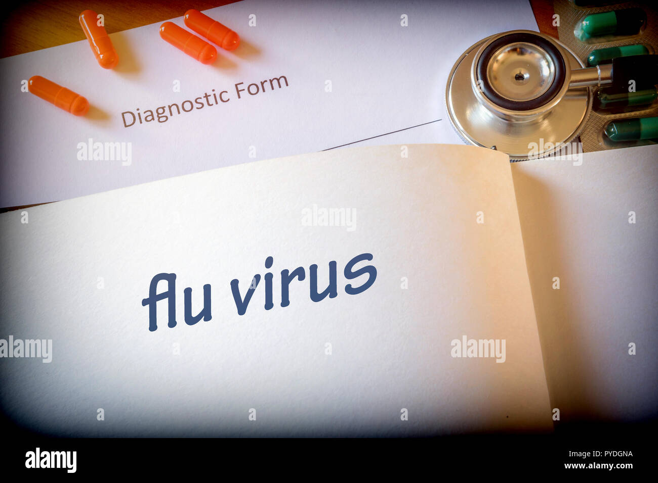 Diagnosis flu virus written in the diagnostic form and pills - Stock Image