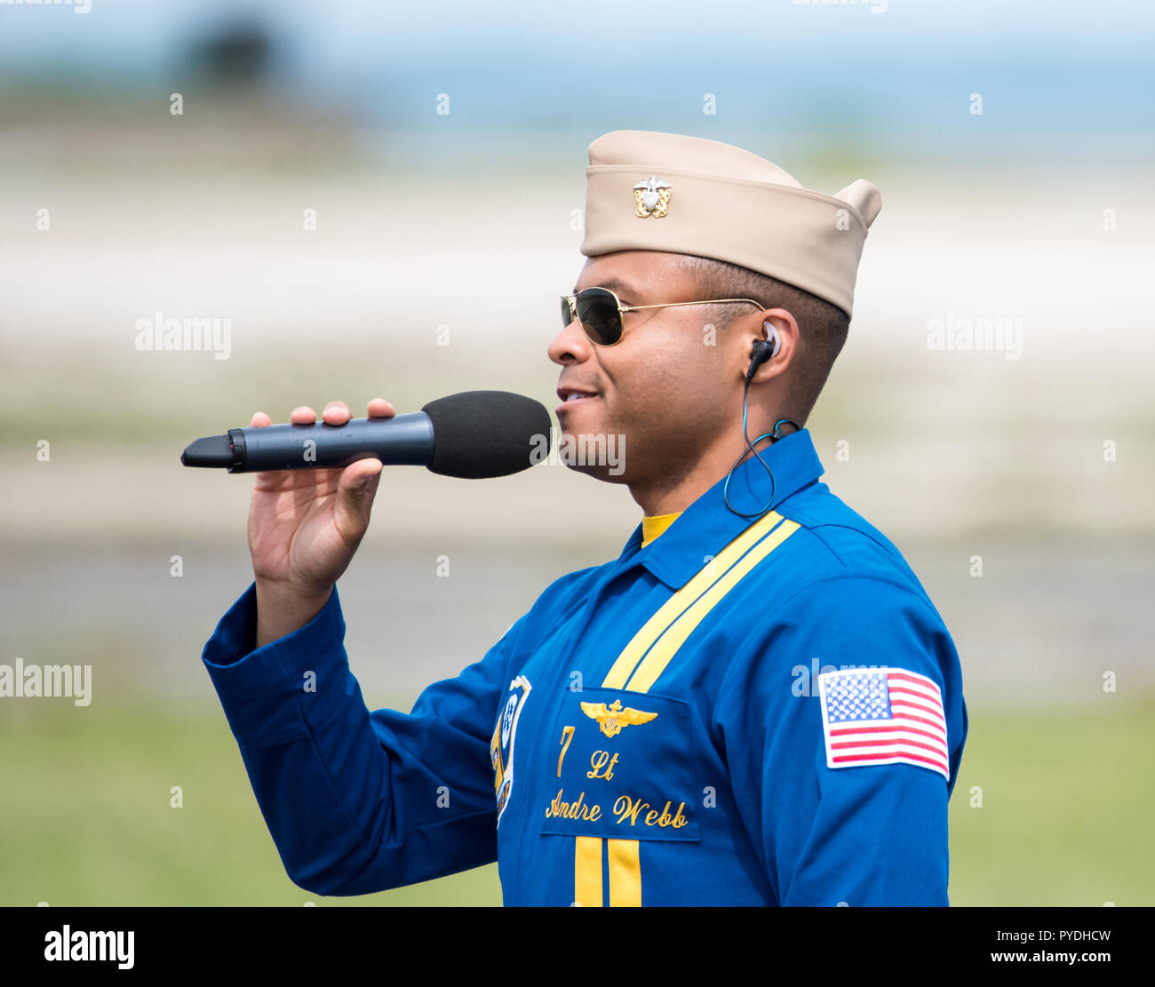 US Navy Blue Angels Lieutenant Commander Andre Webb speaking to the crowd at the Rhode Island National Guard Airshow. - Stock Image