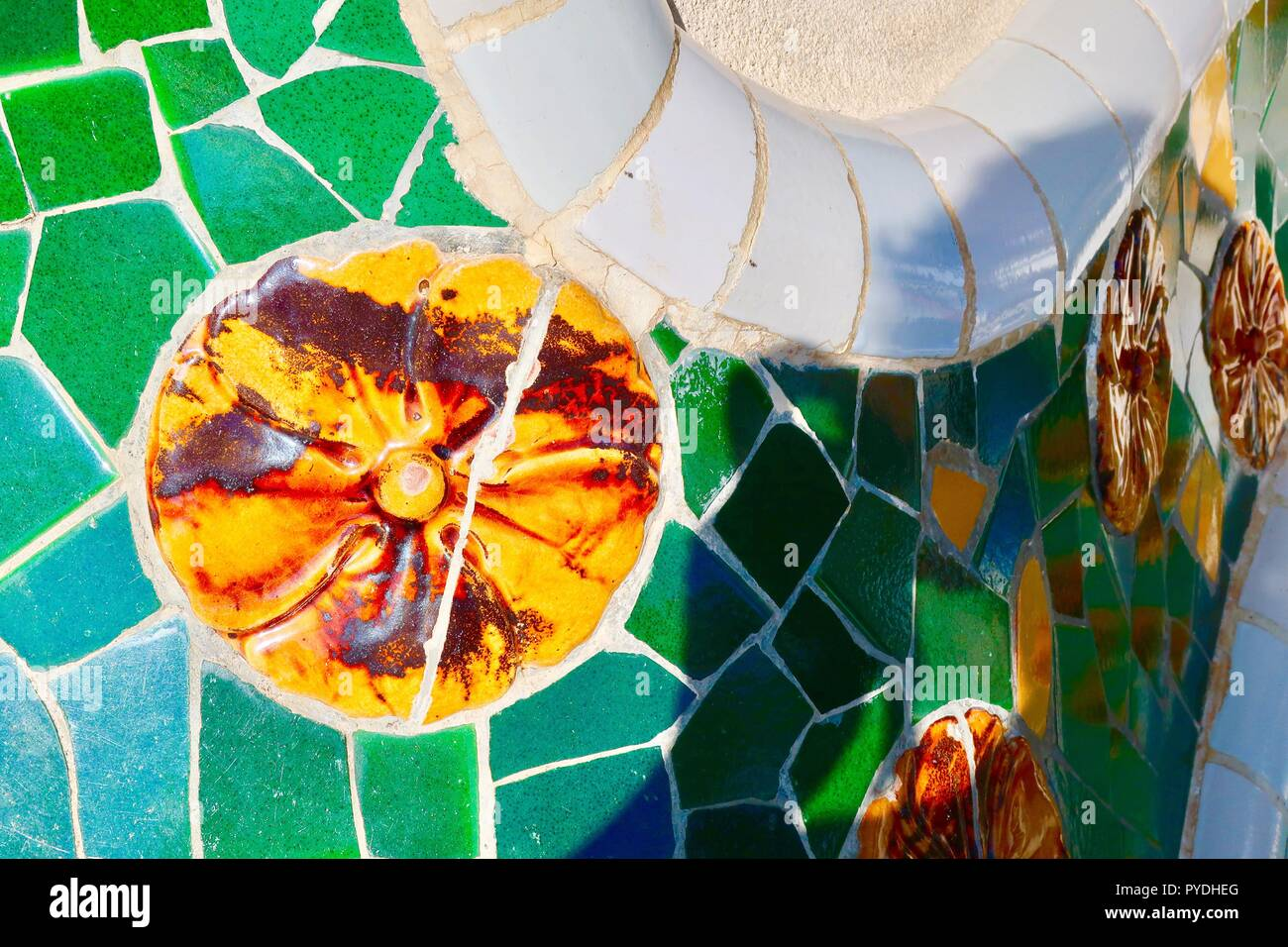 Barcelona, Spain. Mosaic detail at Gaudi's Park Guell on a hot sunny morning. October 2018. - Stock Image