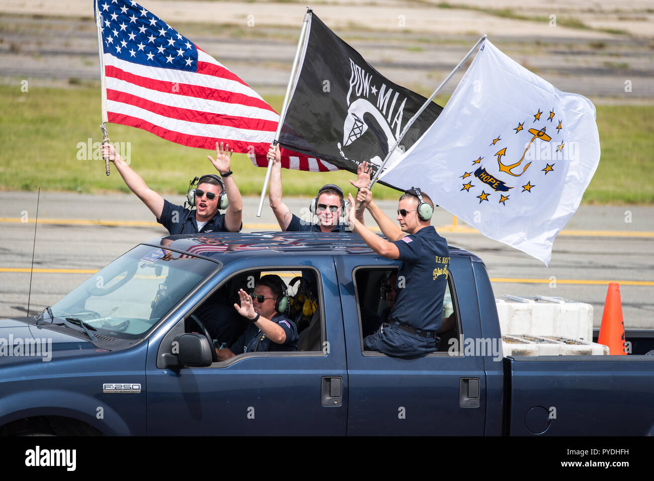 US Navy Blue Angels Ground Crew celebrating and waving to the crowd - Stock Image