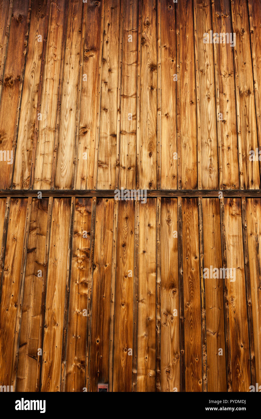 Vintage wood background, vertical planks, old wooden wall from 17th century chapel. - Stock Image
