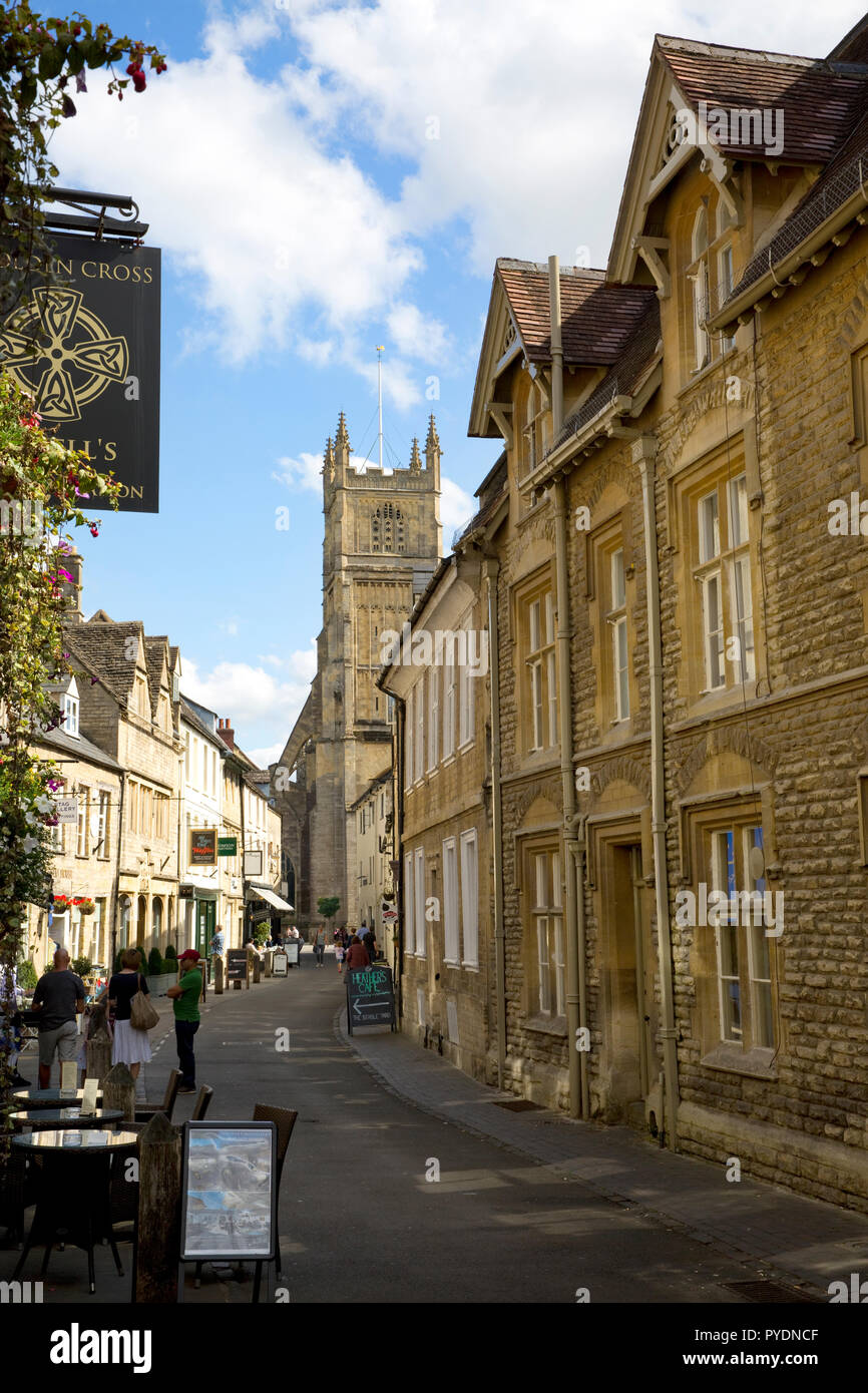 View looking up Black Jack Street to the Church of St John the Baptist, Cirencester, Gloucestershire, England - Stock Image