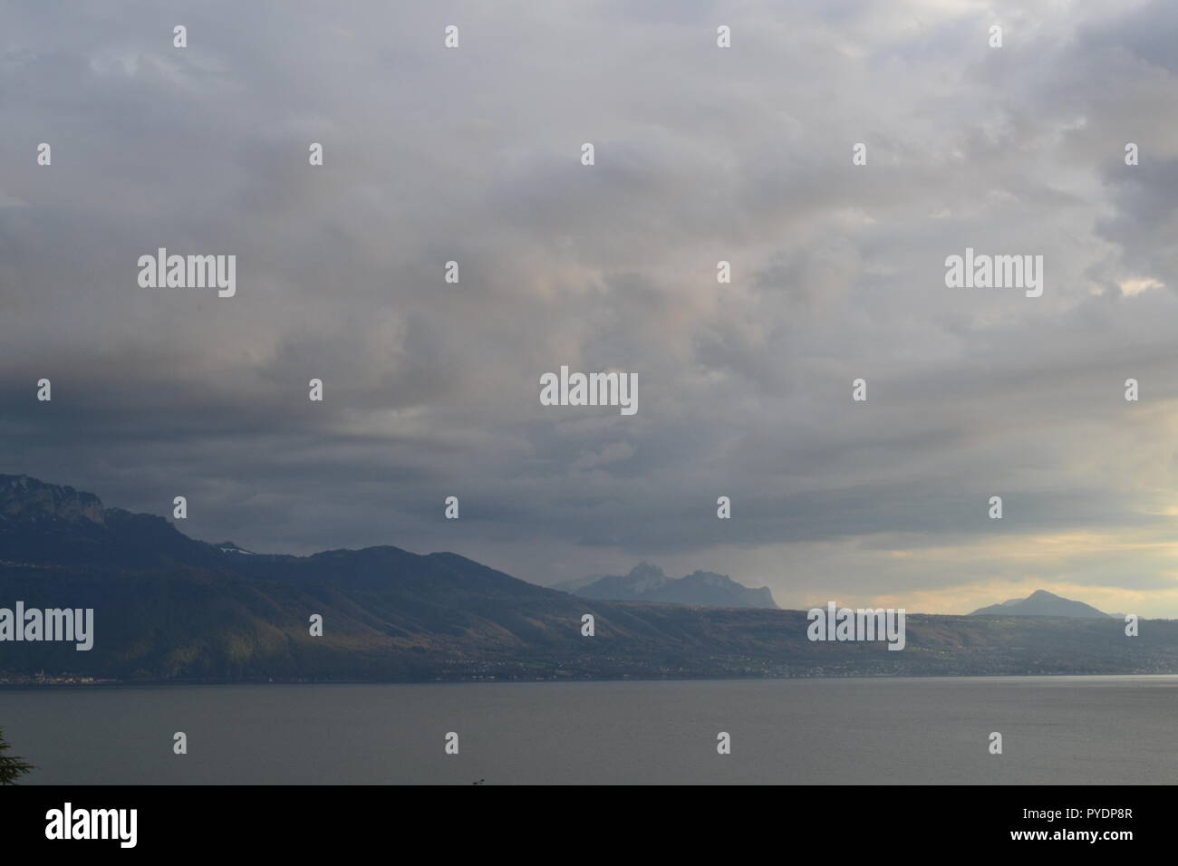 Lake Geneva (Lac Leman) pictured from train passing near Vevey, Vaud, Switzerland - Stock Image