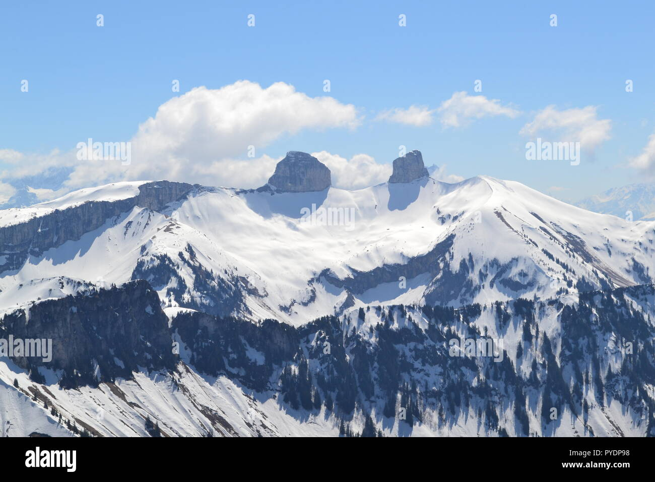 View from Les Rochers de Naye, reached by MOB train from Montreux. Tour d'Aï and Dent de Corjon are in the foreground. Heavy April snow has fallen. - Stock Image