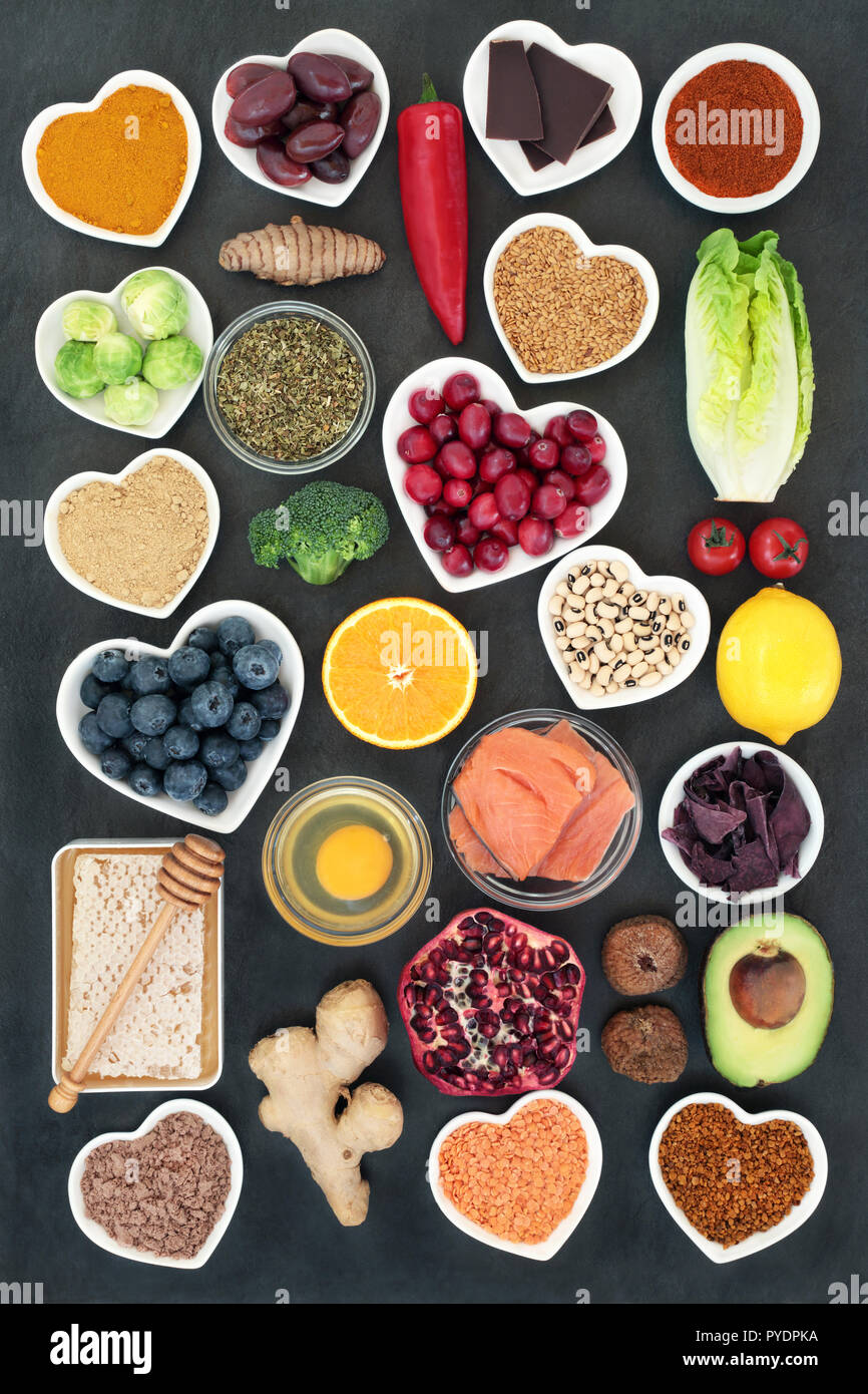 Healthy food to slow the ageing process concept including fruit, vegetables, fish, seeds, spice, dairy, honey and pollen grain. - Stock Image