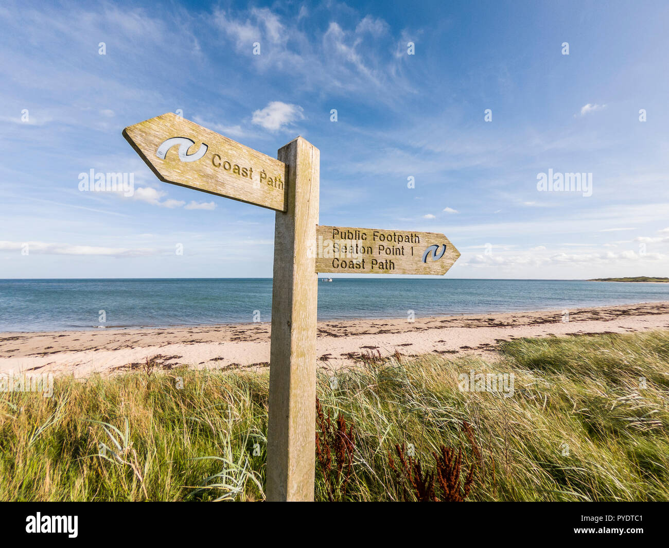 Wooden Sign Post For The Northumberland Coast Path At Boulmer, Northumberland - Stock Image