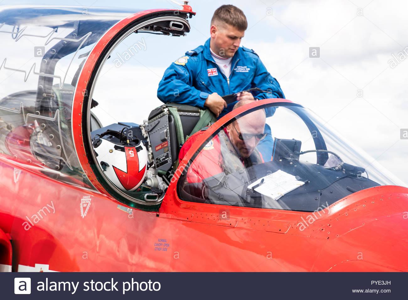 Red Arrows pilots in cockpit on RAF Scrampton, UK Stock Photo