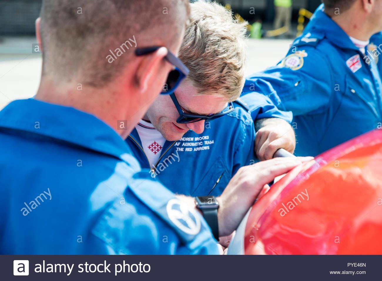 Men working on Red Arrows airplane on RAF Scrampton, UK - Stock Image