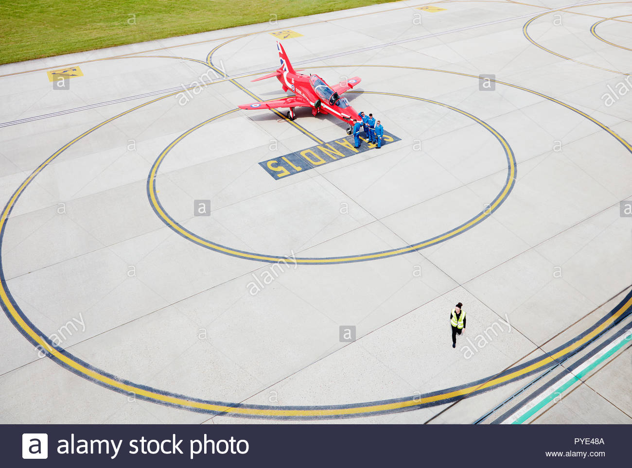 High angle view of Red Arrows airplane on runway on RAF Scrampton, UK - Stock Image