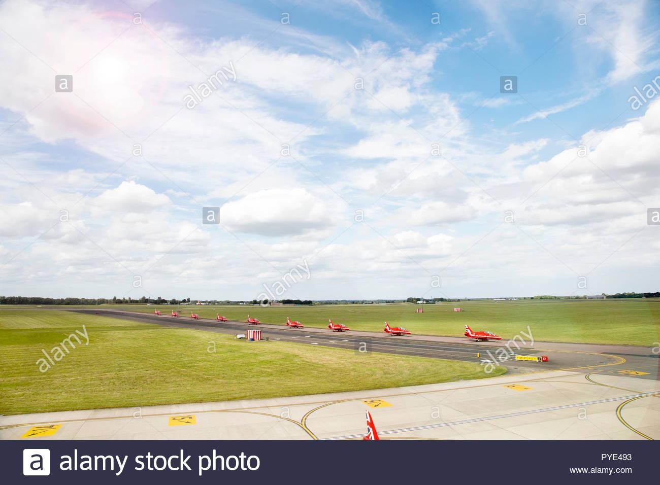 Red Arrows airplanes on runway on RAF Scrampton, UK - Stock Image