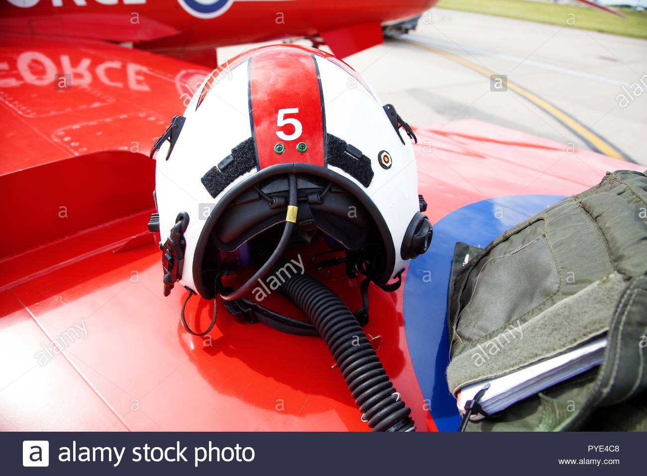 Helmet and bag on wing of Red Arrows airplane on RAF Scrampton, UK - Stock Image