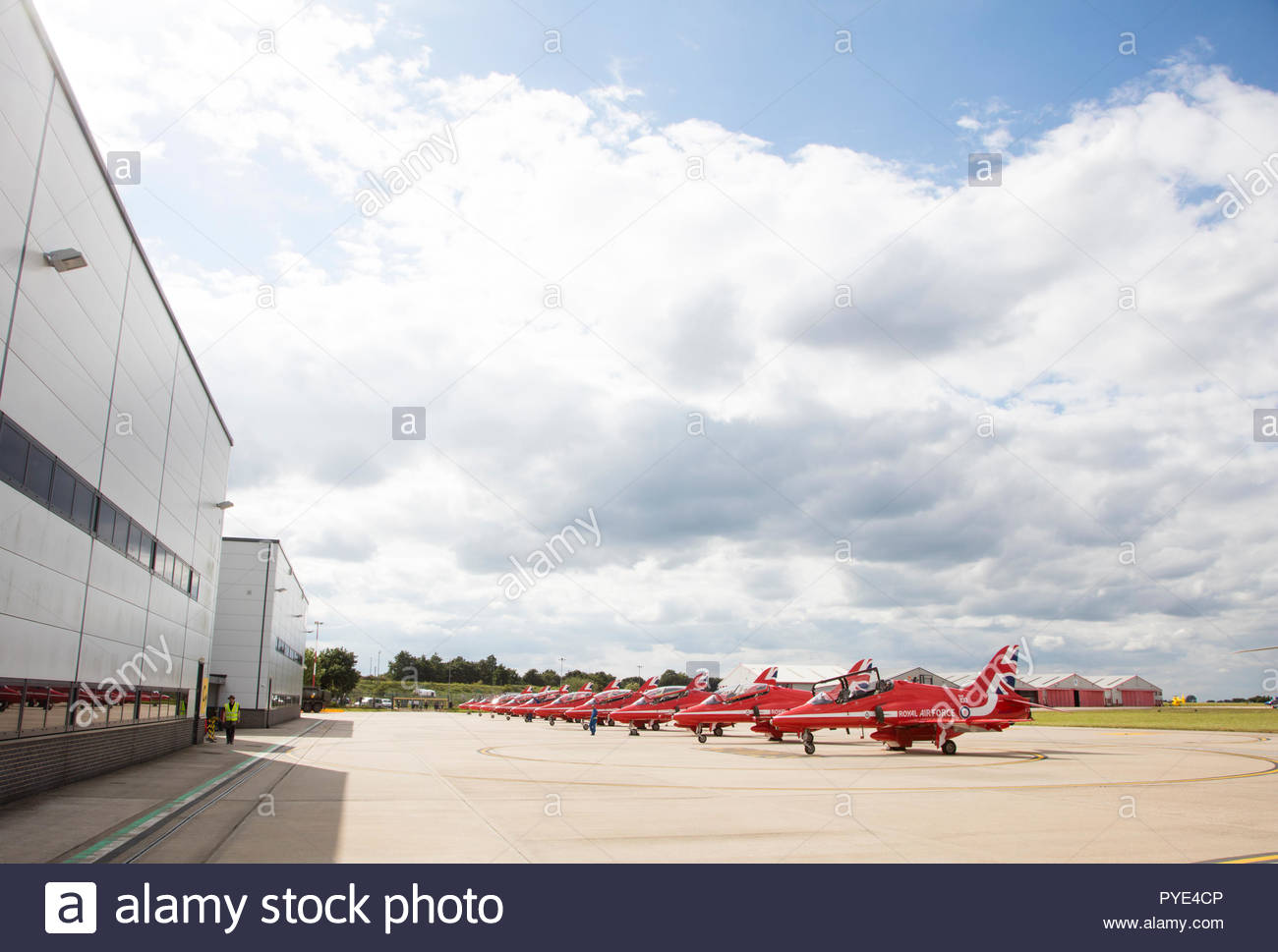 Row of Red Arrows airplanes on RAF Scrampton, UK - Stock Image
