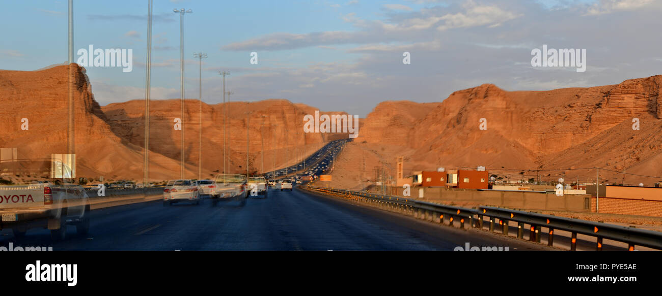 Desert Road and Rocky Mountains - Stock Image