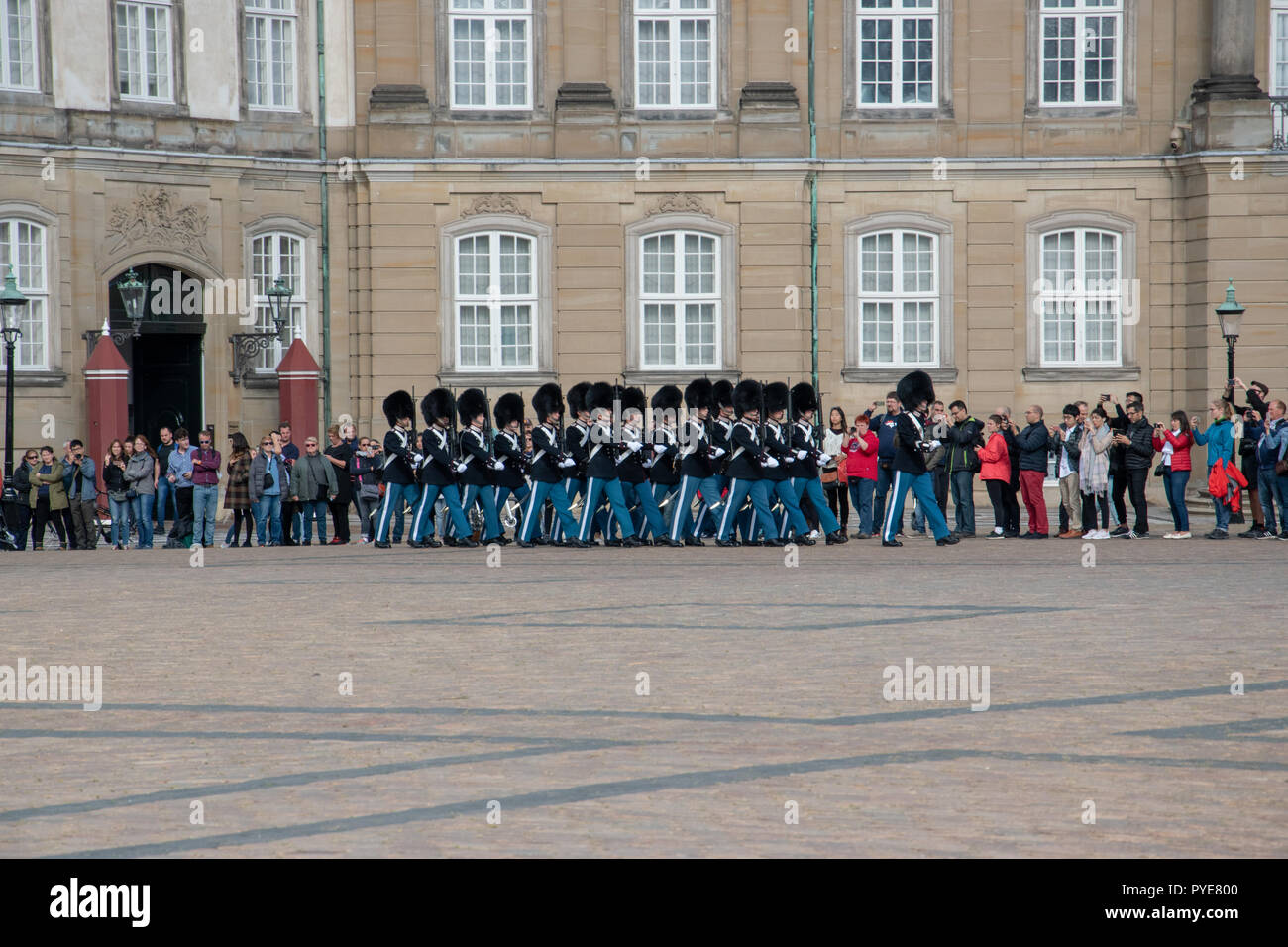 Palace Watch by the Royal Life Guards in Amalienborg Square. A Palace Watch is when no member of the royal family is in the palace. Stock Photo