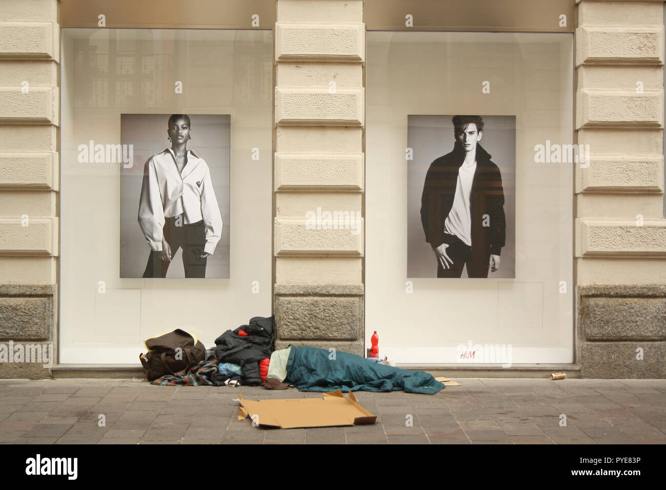 Street is the place where two worlds collide. Rich & Poor. Young & Old. Beautifull & Spiritual. Colorufull & Black and white. Stock Photo
